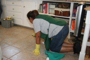 Mini Mops House Cleaning in Fresno CA - crew member scrubbing a floor