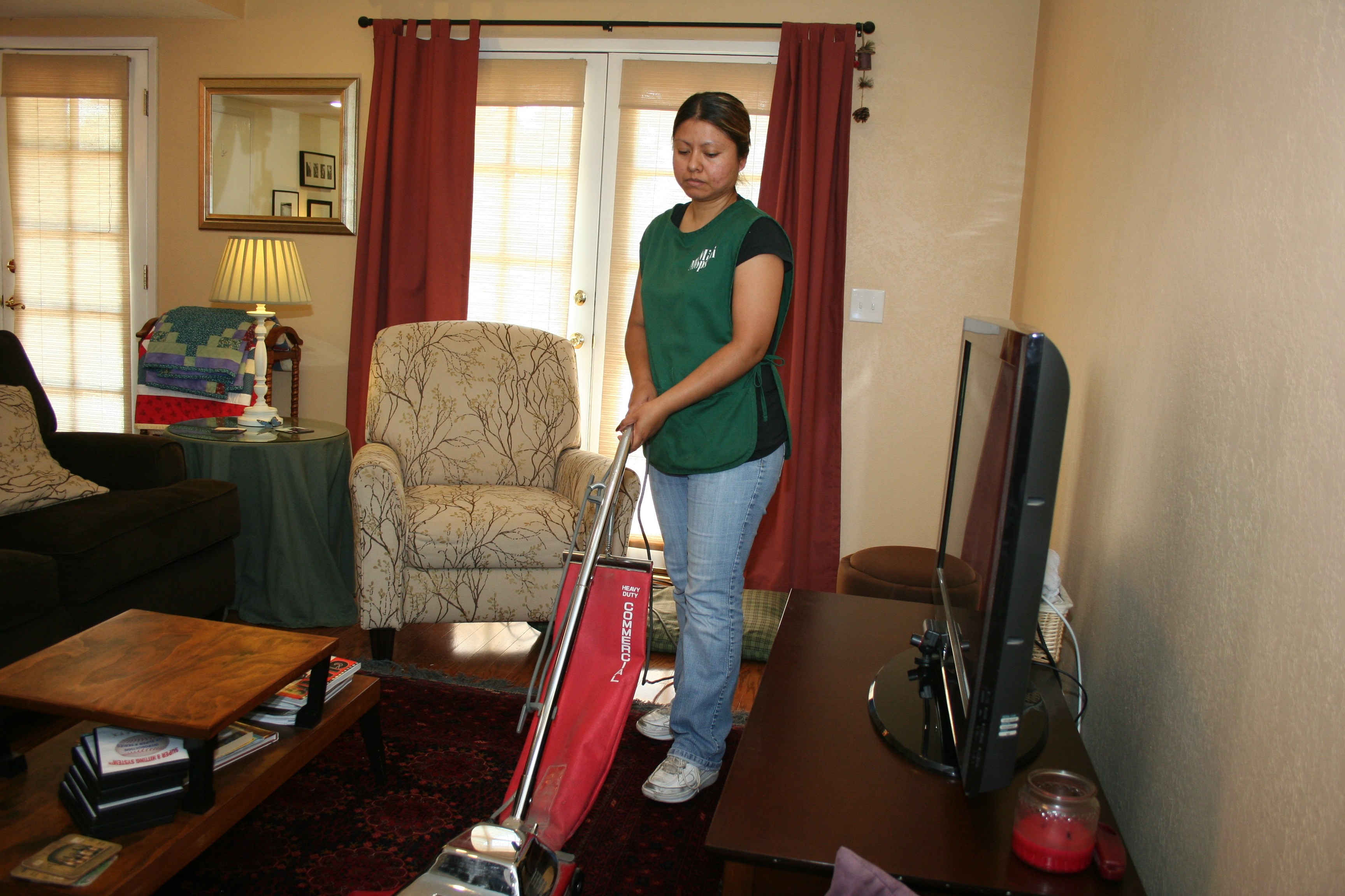 Mini Mops House Cleaning in Fresno CA - crew member vacuuming